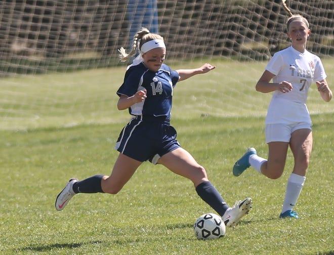 TMP senior Abby Rueschhoff possesses the ball against Hays High on Thursday.
