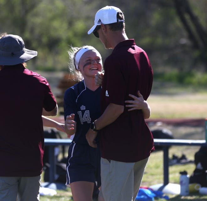TMP-Marian senior Abby Rueschhoff hugs her brother, Hays High soccer coach Tyler Rueschhoff after Thursday's game at TMP. Hays High took the win, 4-0.