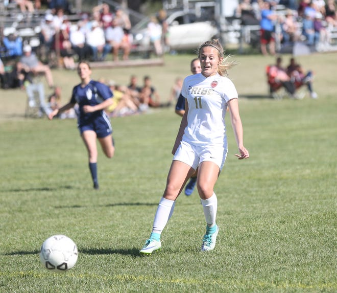 Hays High's Madelyn Martin watches her kick go into the net for a goal last Thursday against TMP. The Indians clinched the WAC title on Monday.