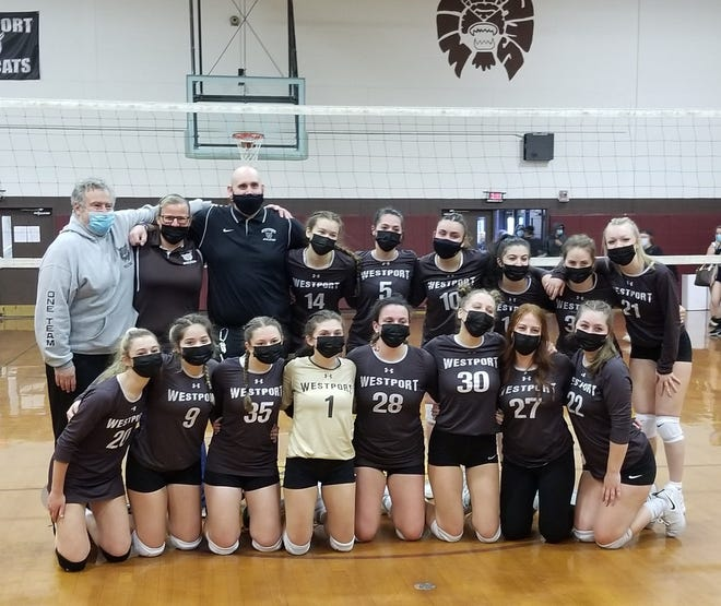Members of the Westport girls volleyball team after completing an undefeated season.