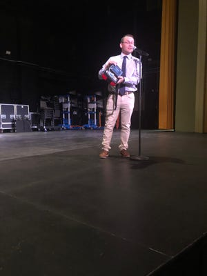 Cody Jenkins demonstrates an AED to volunteers and staff at the Fox Theatre.