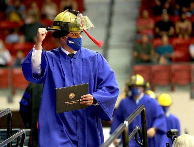 Nathaniel Landin from Johnson City, fist pumps to the audience after he received his Associate of Applied Science degree in Fire Science Friday at the Sports Arena during Hutchinson Community College's 93rd Annual Commencement.