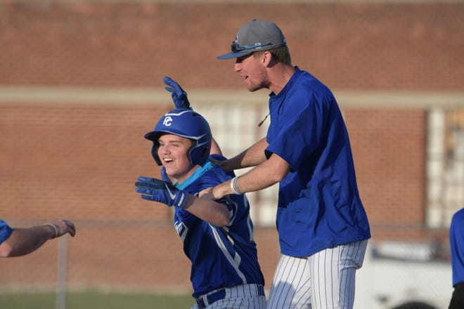 Putnam County's Brayden McReynolds cheers with assistant coach Calvin Heidenwith after hitting a walk-off single to beat Green City on Friday night.