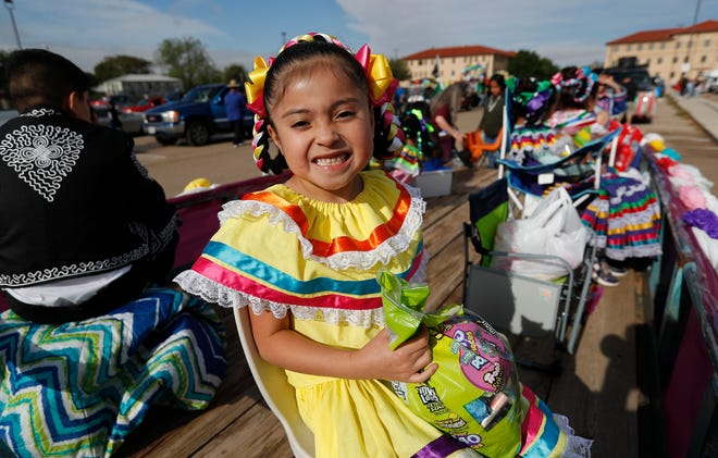 """Six-year-old Xiamara Lopez of the Ballet Folklorico Aztlan dance group waits for the parade to start. Lubbock's Cinco de Mayo parade traveled down Broadway from First Baptist Church to the Lubbock Memorial Civic Center Saturday morning, May 1, 2021. This year's theme was """"!Flores y Colores!""""Organizations, schools, youth, and families participated in this year's parade celebrating thecultural history and contributions of the Mexican American community. (Mark Rogers/For A-J Media)"""
