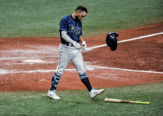 Tampa Bay's Brandon Lowe tosses his helmet after striking out during the sixth inning of the team's game against the Texas Rangers on April 14. Lowe is just one of many Rays' bats that are struggling early in the year.