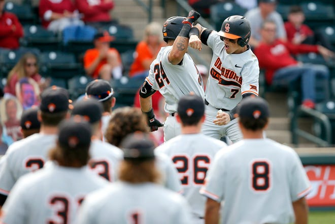 Oklahoma State's Max Hewitt (7) celebrates a home run with Christian Encarnacion-Strand (24) in the fifth inning of last Saturday's game at Oklahoma.