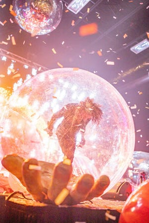 The Flaming Lips frontman Wayne Coyne performs at one of the Oklahoma City band's hometown Space Bubble Concerts at The Criterion.