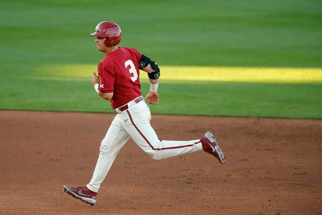Oklahoma's Jimmy Crooks runs the bases after hitting a home run on April 30 against Oklahoma State in Stillwater.