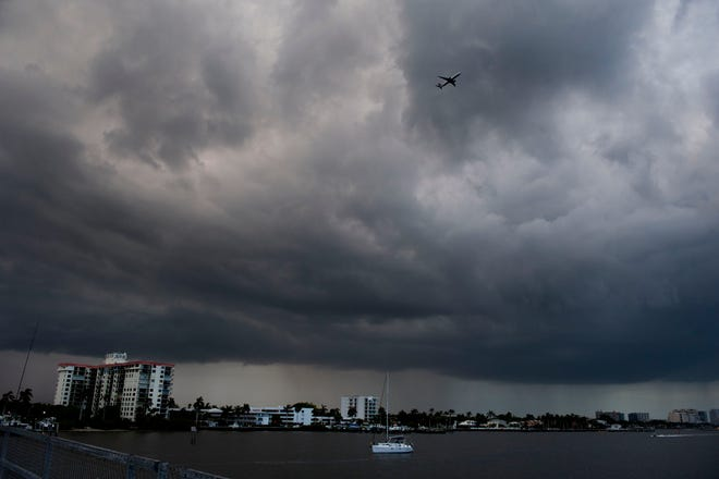 Rain clouds gather over West Palm Beach north of the Southern Bridge Friday evening April 30, 2021. MEGHAN McCARTHY/The Palm Beach Post