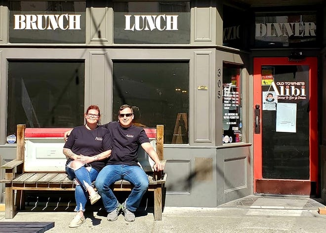 """Old Towne's Alibi current owner Dino Lunsford and future owner Kathleen """"Kat"""" McCay pose for a photo in Petersburg on April 30, 2021."""