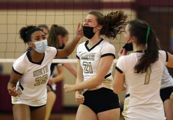 North Kingstown's Cadia Greene, center, celebrates with teammates Cassidy Cole, left, and Ava Mattiucci after slamming the ball for a point during their Division I title match against South Kingstown on Saturday.