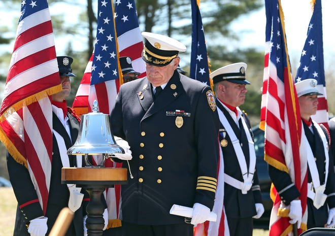 Fire Academy Director Mark S. Pare rings a bell for all fallen Rhode Island firefighters during a ceremony Saturday at the R.I Firefighters Memorial in Exeter.