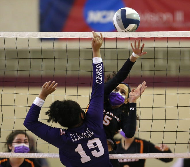 West Warwick's Amaya Louro, right, ties to get the ball past Classical's Valerie Cruz tries to block in Saturday's Division II championship match.