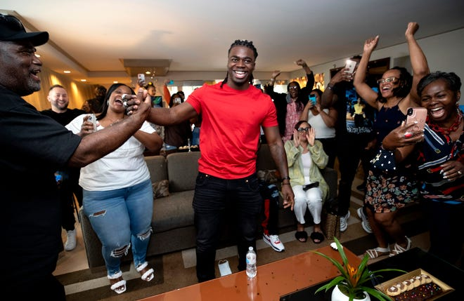 Oklahoma running back Rhamondre Stevenson, center, is congratulated by family and friends in a suite at the Aria Resort in Las Vegas after he was selected in the fourth round of the NFL draft by the New England Patriots on Saturday.
