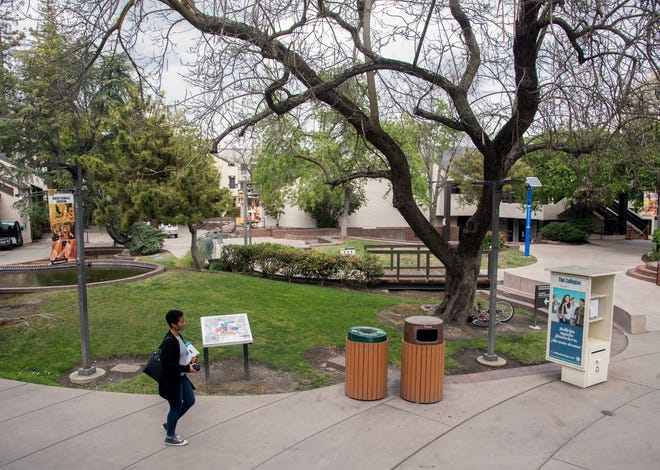 (3/18/20)A lone student was across the San Joaquin Delta College campus which is largely empty with most classes being held online due to concerns over the Covid-19 virus. [CLIFFORD OTO/THE RECORD]