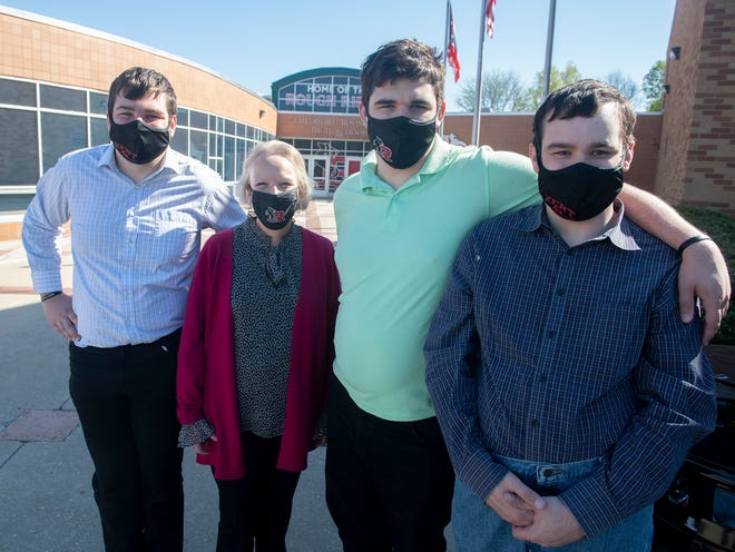 Ellen Pochedley Hardgrove with former students, brothers Daniel Smolk, Michael Smolk and Nate Smolk.