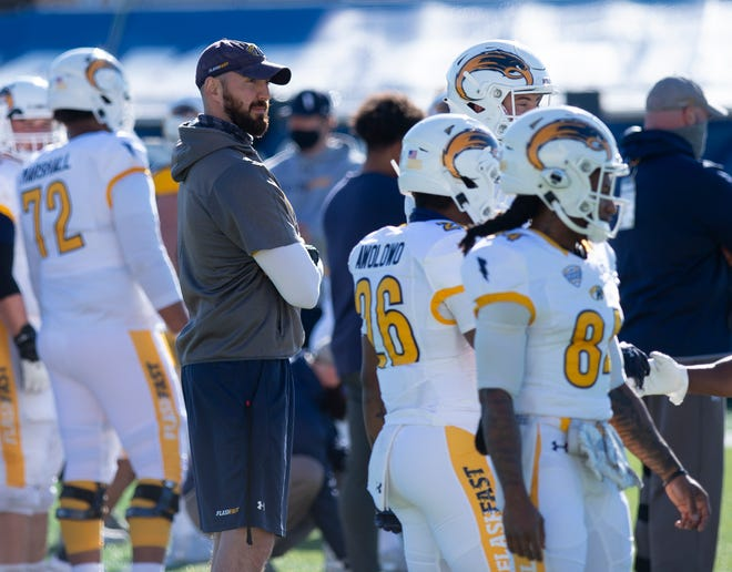 Kent State head coach Sean Lewis is pictured with his players during the team's annual Spring Game held last April at Dix Stadium.