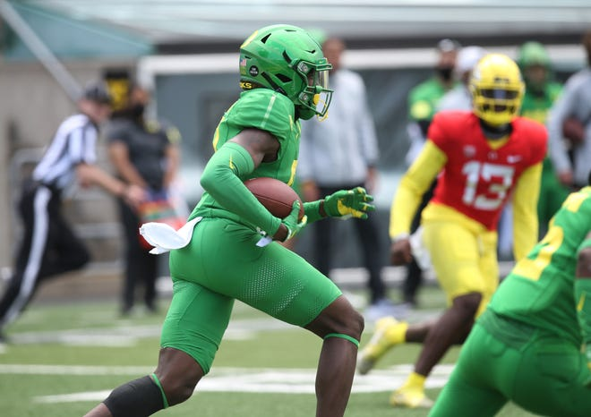 Oregon's Dontae Manning returns an interception from the goal line during the second half of the spring game at Autzen Stadium.