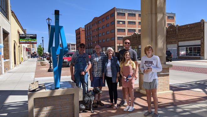 """Salinan Bob Peck, second from the left, stands with his family next to """"Santa Fe Strut,"""" his submission for the 2021 SculptureTour Salina. Peck has submitted a piece for several years."""
