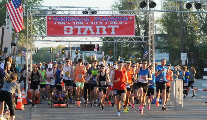 Runners take off at the start of the Eisenhower Marathon on Buckeye Avenue south of downtown Abilene on Saturday morning. First-time marathoner Layton Werth of Quinter was the men's winner and Wichita's Angela Gerstenkorn the top women's finisher.