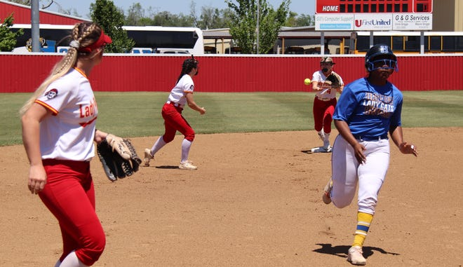 Dale shortstop Emilia Idleman tosses the ball to second baseman Danyn Lang for the force out against Hobart Friday.