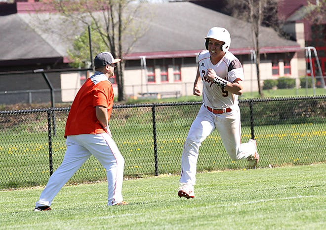 Rylee Cain of Sturgis rounds third on his way home to score a run for the Trojans on Friday afternoon.