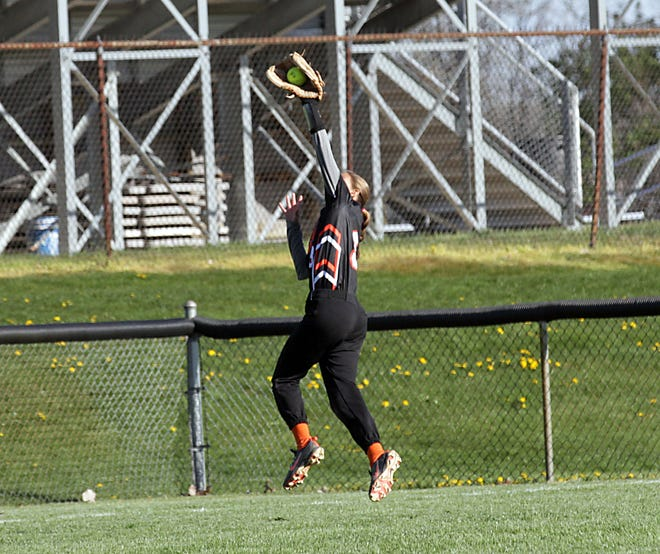 Alyssa Netke of Sturgis makes a leaping catch in left field against Paw Paw on Friday afternoon.