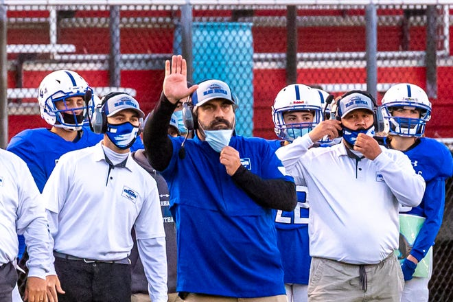 Fairhaven Head Coach, Derek Almeida, calls in the plays from the sidelines.
