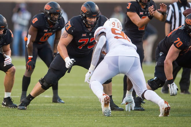 Oklahoma State offensive tackle Teven Jenkins (73) was selected with the No. 39 pick in the 2021 NFL Draft by the Chicago Bears on Friday evening. Jenkins is a Topeka High product.