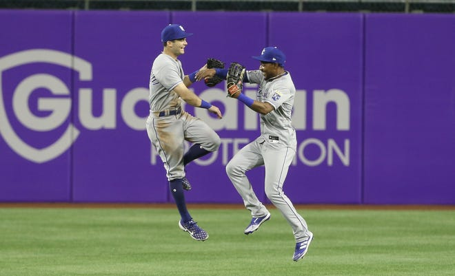 Kansas City Royals left fielder Andrew Benintendi, left, and right fielder Jarrod Dyson celebrate after defeating the Pittsburgh Pirates 9-6 on Wednesday at PNC Park in Pittsburgh. The Royals finished April with a 15-9 record.