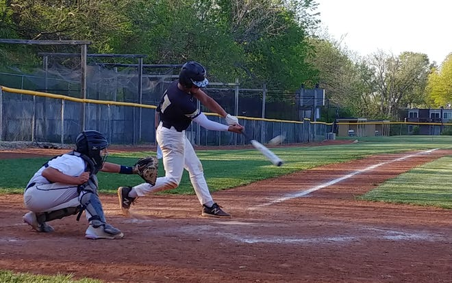 Topeka High junior shortstop Max Colombo puts a ball in play in Game 2 of his team's doubleheader Friday at Hayden. Colombo notched five RBI in Game 1 and picked up the save in Game 2 to power the Trojans to a sweep of the Wildcats.