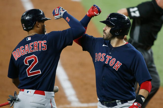 Red Sox shortstop Xander Bogaerts (left) hit a home run in Saturday night's win over the Baltimore Orioles.