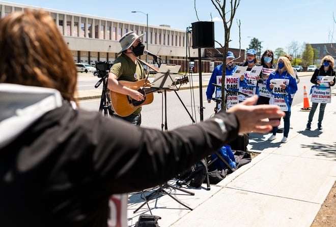 WORCESTER - Ben Grosscup performs for the St. Vincent Hospital nurses as they continue their strike on Saturday, May 1, 2021.