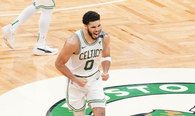 Celtics forward Jayson Tatum reacts after scoring a basket against the Spurs during the fourth quarter at TD Garden.