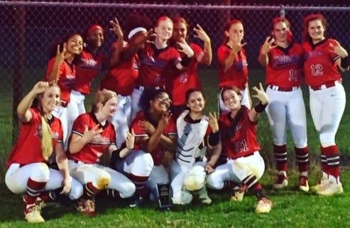 Williston softball team celebrates win.