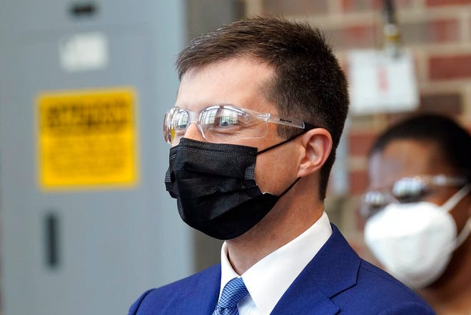Transportation Secretary Pete Buttigieg observes a demonstration in the engineering department at North Carolina State University in Raleigh, N.C., Friday, April 30, 2021. (AP Photo/Gerry Broome, Pool)