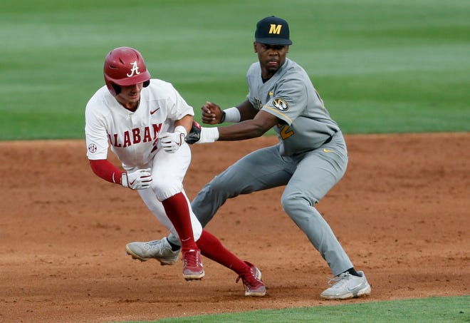 Alabama base runner Caden Rose (7) is caught in a rund down and tagged out by Missouri shortstop Joshua Day. Alabama hosted Missouri in the first game of a weekend series Friday, April 30, 2021, in Sewell-Thomas Stadium. [Staff Photo/Gary Cosby Jr.]