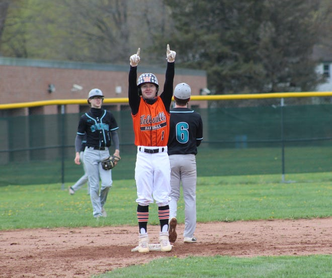 Wellsville's Alex Ordiway points to the dugout after hitting a bases-clearing double against Arkport-Canaseraga Friday.