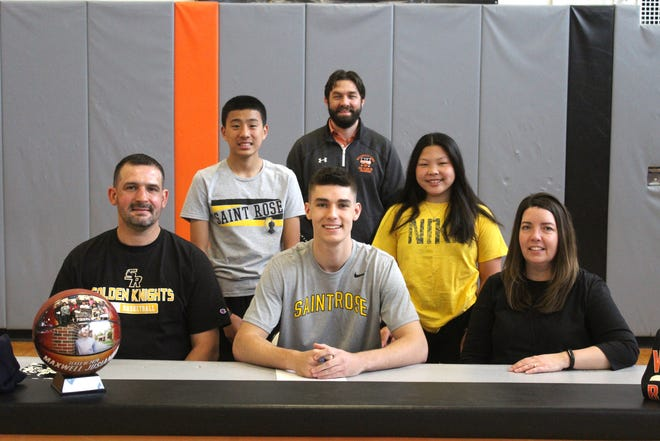 Wellsville grad Max Jusianiec signed his letter of intent Friday to attend Division II St. Rose on a full scholarship. He was joined by his parents, Jerry and Melissa, his siblings Jack and Isabel, and Wellsville coach Raymie Auman.