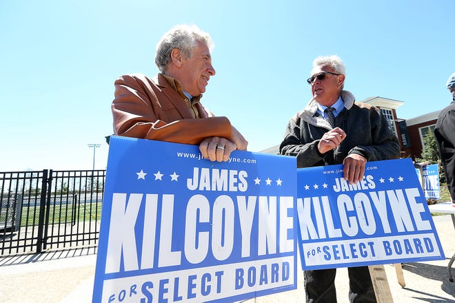 Paul Vercollone of Marshfield chats with James Kilcoyne while helping him campaign during town election at Marshfield High on Saturday, May 1, 2021.