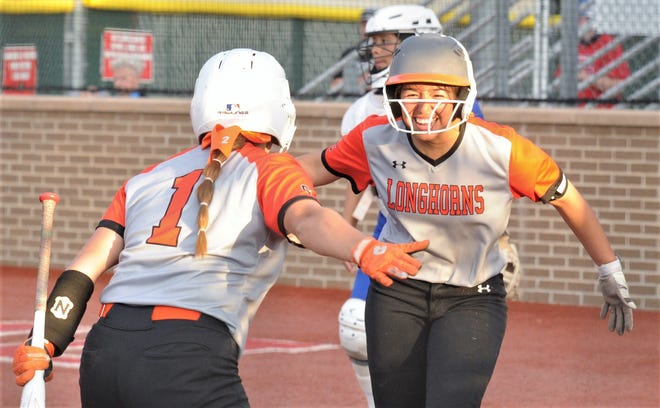 Amarillo Caprock's Brooklyn Thompson, right, celebrates with Aubri Hernandez after scoring on an error in the third inning against Cooper. The Lady Coogs beat Caprock 19-5 in Game 1 of the best-of-three Region I-5A bi-district playoff series Friday, April 30, 2021 at Lubbock-Cooper.