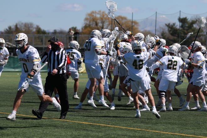 UVM men's lacrosse celebrates its last-second victory over Stony Brook to secure the first share of the America East regular-season crown in program history.