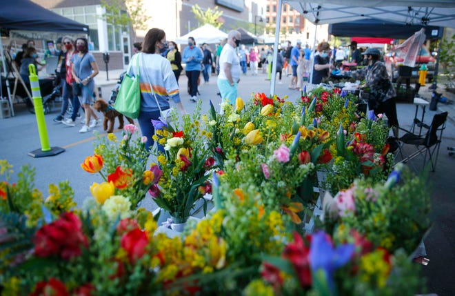 The Des Moines Downtown Farmers' Market kicked off the 2021 season on Saturday, May 1, 2021, with new COVID-19 restrictions including one-way foot traffic, limited vendors and hand sanitizing stations.