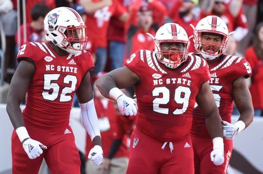 North Carolina State Defense Alim McNeill celebrates his fight against Florida State on Nov. 3, 2018 in Raleigh, NC.