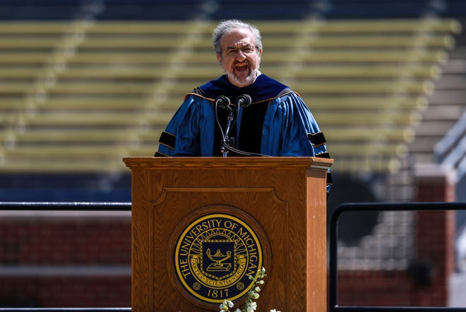 President Mark Schlissel briefly speaks at the University of Michigan Class of 2021 spring commencement during a virtual ceremony at the Michigan Stadium in Ann Arbor on May 1, 2021. Graduates are invited to experience the virtual celebration from the stands at Michigan Stadium. Due to ongoing health and safety concerns and current capacity limitations for the stadium, family and friend attendance is prohibited.