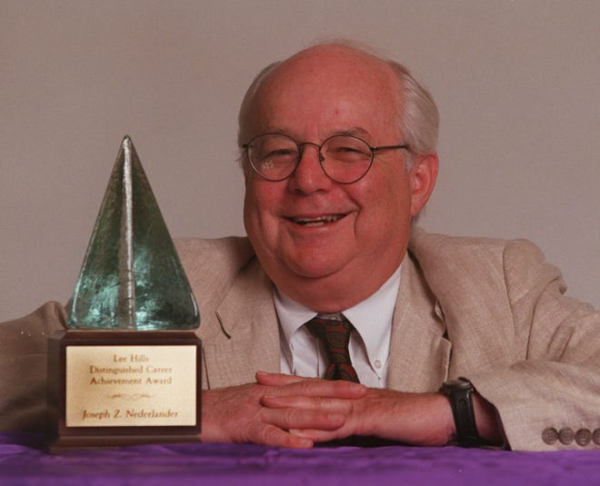 This is Joseph Z. Nederlander of theater fame in the Detroit Free Press photo dept.  He is photographed with the Lee Hills Distinguished Career Achievement Award that was presented to him.