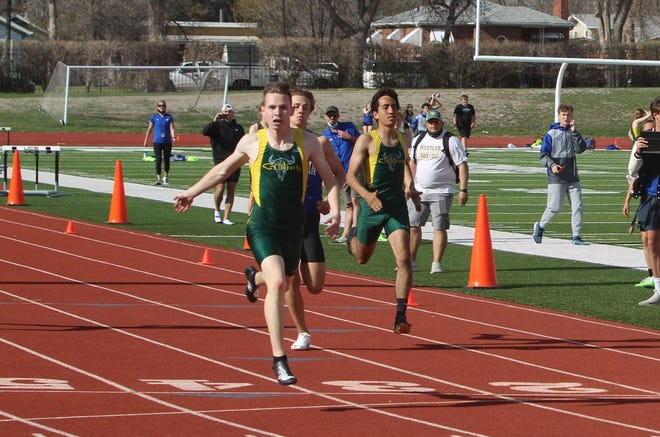 C.M. Russell's Rafe Premo (center) wins the boys' 400 meters Friday afternoon in the Rustlers' dual with Gallatin at Memorial Stadium.