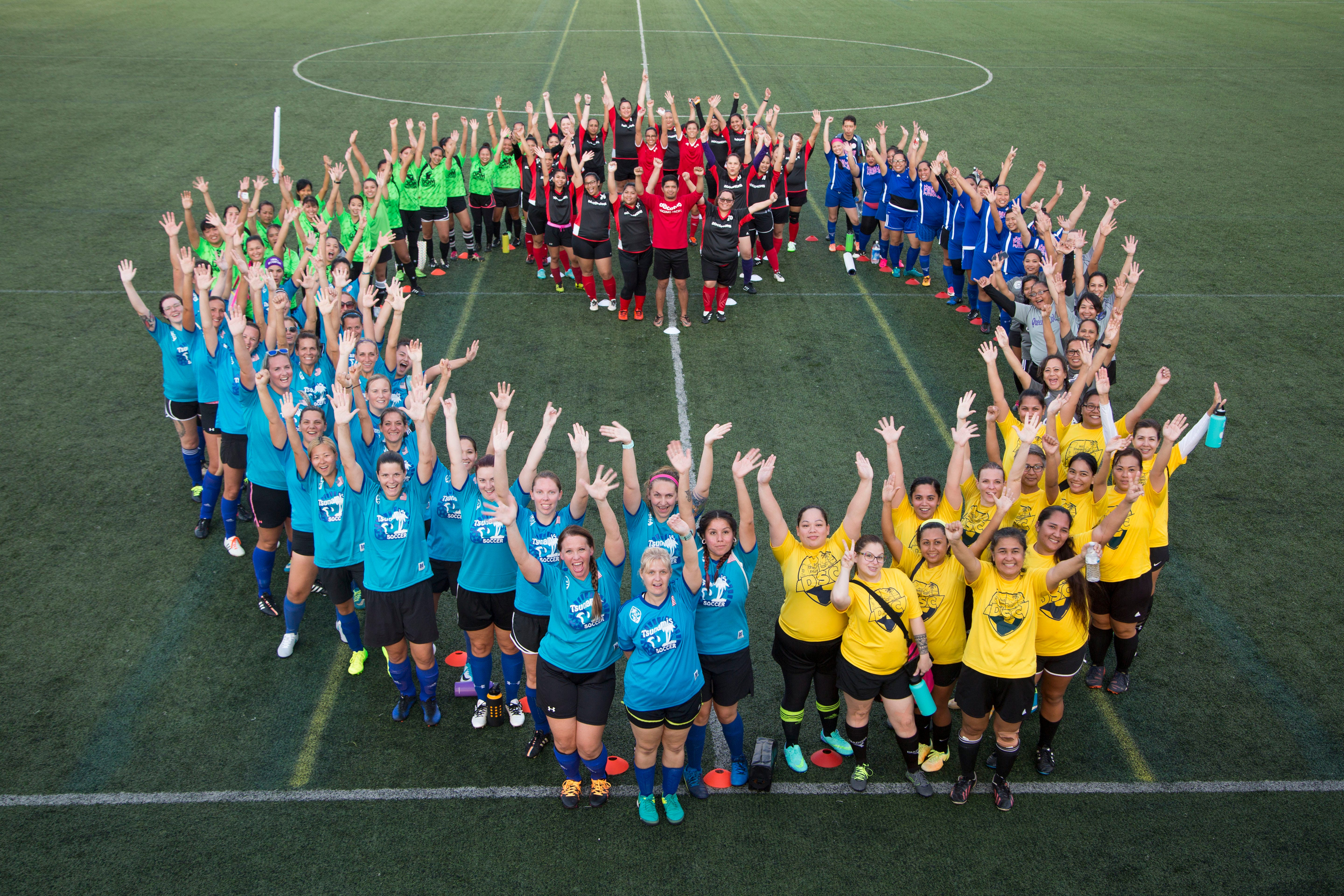 Teams participating in the 2018 Docomo Pacific Soccer Moms League pose for a group photo ahead of that year's Spring season matches in this file photo.