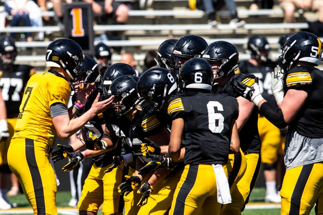 Iowa quarterback Spencer Petras, left, calls a play during the Hawkeyes' final spring practice in May. Petras finished his first season as a starter strong, throwing for 431 yards, five touchdowns and no interceptions in easy victories over Illinois and Wisconsin.
