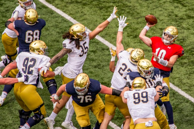 Notre Dame quarterback Drew Pyne (10) throws downfield during the Blue-Gold NCAA spring football game on Saturday, May 1, 2021, in South Bend, Ind. (AP Photo/Robert Franklin)